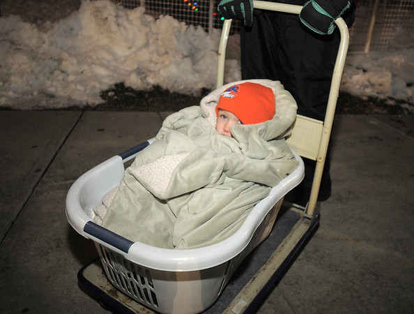 Daniel McArthur, 4, bundled up in a make shift stroller made by his grand mothers watches the tree lighting ceremony at the George Di Ciero City and County Building on Friday.<br /> <br /> December 2, 2011<br /> staff photo/ David R. Jennings