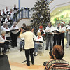 The Broomfield Civic Chorus entertains the crowds inside after  the tree lighting ceremony at the George Di Ciero City and County Building on Friday.<br /> <br /> December 2, 2011<br /> staff photo/ David R. Jennings