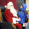Logan Walker, 9, brought a present for Santa after the tree lighting ceremony at the George Di Ciero City and County Building on Friday.<br /> <br /> December 2, 2011<br /> staff photo/ David R. Jennings