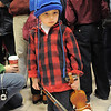 Simon Walker, 3, waits to play  the violin with the  Suzuki Violin Students during the tree lighting ceremony at the George Di Ciero City and County Building on Friday.<br /> <br /> December 2, 2011<br /> staff photo/ David R. Jennings