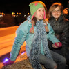 Westlake students Samantha Bryson, 12, left, and Dione Horne, 11, sing Christmas carols during the hayride after the tree lighting ceremony at the George Di Ciero City and County Building on Friday.<br /> <br /> December 2, 2011<br /> staff photo/ David R. Jennings