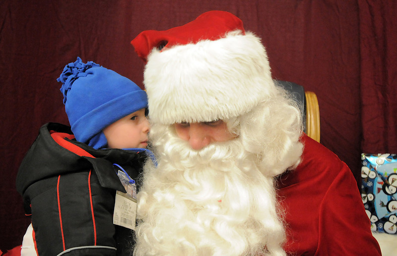 Casey Walker, 5, whispers his wish list to Santa during the tree lighting ceremony at the George Di Ciero City and County Building on Friday.<br /> <br /> December 2, 2011<br /> staff photo/ David R. Jennings