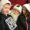 Santa chats with Justice Brashear, 10, left, and his sister Sheridan , 7,  after the Mayor's Tree Lighting Ceremony at the George Di Ciero City and County Building on Friday.<br /> <br /> December 7, 2012<br /> staff photo/ David R. Jennings