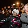 Ramona Allen Bruno, 9, left, and Addis Daybill, 10, sign with the Mountain View Sign Language Choir during the Mayor's Tree Lighting Ceremony at the George Di Ciero City and County Building on Friday.<br /> <br /> December 7, 2012<br /> staff photo/ David R. Jennings