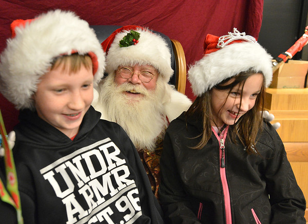 Santa chats with Justice Brashear, 10, left, and his sister Sheridan , 7,  after the Mayor's Tree Lighting Ceremony at the George Di Ciero City and County Building on Friday.<br /> <br /> <br /> December 7, 2012<br /> staff photo/ David R. Jennings