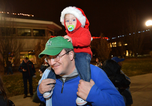 Scott Troy and his son Carter, 20 months old watch the ceremonies during the Mayor's Tree Lighting Ceremony at the George Di Ciero City and County Building on Friday.<br /> <br /> December 7, 2012<br /> staff photo/ David R. Jennings