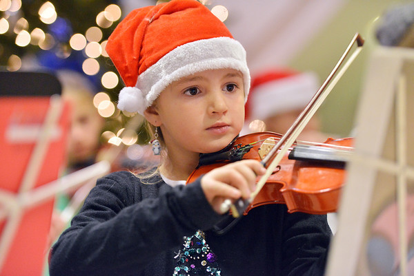 Mackenzie Bell, 8, performs with the Suzuki Violin students in the lobby of the George Di Ciero City and County Building for the Mayor's Tree Lighting Ceremony on Friday.<br /> <br /> December 7, 2012<br /> staff photo/ David R. Jennings