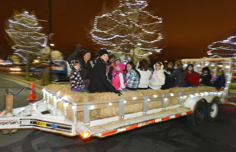 Revelers ride on the hayride after the Mayor's Tree Lighting Ceremony at the George Di Ciero City and County Building on Friday.<br /> <br /> December 7, 2012<br /> staff photo/ David R. Jennings