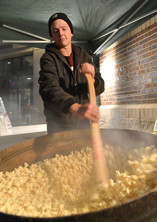 Mitch Lincoln cooks kettle popcorn for people attending the Mayor's Tree Lighting Ceremony at the George Di Ciero City and County Building on Friday.<br /> <br /> December 7, 2012<br /> staff photo/ David R. Jennings