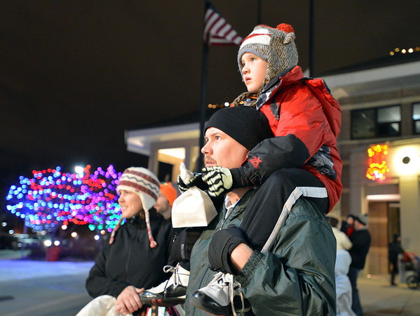 Nate Olsen with his son Chip, 5, watch for Santa arriving by helicopter during the Mayor's Tree Lighting Ceremony at the George Di Ciero City and County Building on Friday.<br /> <br /> December 7, 2012<br /> staff photo/ David R. Jennings