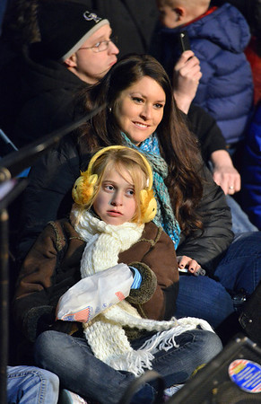 Marci Machuga and her daughter Jordan, 8, listen to the Mountain View Elementary  Sign Language Choir during the Mayor's Tree Lighting Ceremony at the George Di Ciero City and County Building on Friday.<br /> <br /> December 7, 2012<br /> staff photo/ David R. Jennings