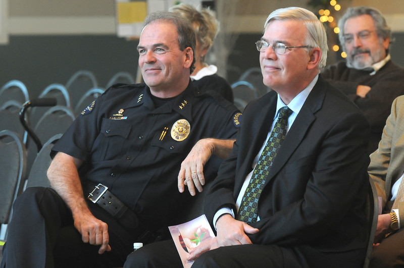 Broomfeild Police Chief Tom Deland, left, and Mayor Pat Quinn listen to the stories and memories of Shirley McGuinness during the memorial service for McGuinness the late executive director of Broomfield F.I.S.H. at the Chateaux at Fox Meadows on Monday.<br /> <br /> January 18, 2010<br /> Staff photo/David R. Jennings