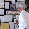 Clark Greip looks at a display showing some of the letters to FISH and Shirley McGuinness before the memorial service for McGuinness the late executive director of Broomfield F.I.S.H. at the Chateaux at Fox Meadows on Monday.<br /> <br /> January 18, 2010<br /> Staff photo/David R. Jennings