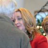 Acting Director of FISH Julie Massingill listens to an attendee after  the memorial service for Shirley McGuinness the late executive director of Broomfield F.I.S.H. at the Chateaux at Fox Meadows on Monday.<br /> <br /> January 18, 2010<br /> Staff photo/David R. Jennings