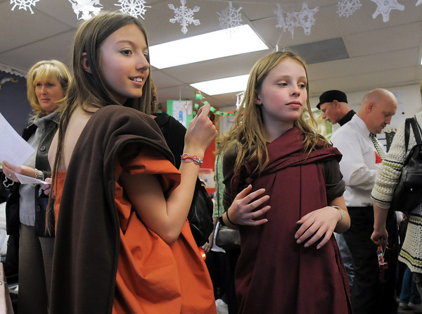Genna Pachner, left, and Caitie Smith dress for Bodhi Day during the 5th grade Winter Celebrations event on Thursday at Meridian Elementary School.<br /> December, 2010<br /> staff photo/David R. Jennings