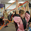 Savannah O'Dowd, right, holds ribbons for a Chinese New Year dance  during the 5th grade Winter Celebrations event on Thursday at Meridian Elementary School.<br /> December, 2010<br /> staff photo/David R. Jennings