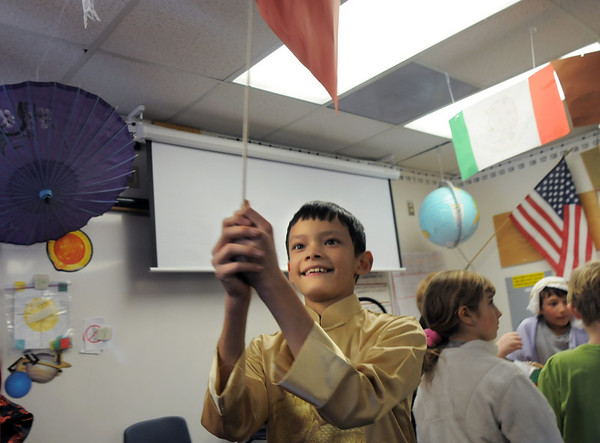 James Wong waves a flag for the Chinese New Year during the 5th grade Winter Celebrations event on Thursday at Meridian Elementary School.<br /> December, 2010<br /> staff photo/David R. Jennings