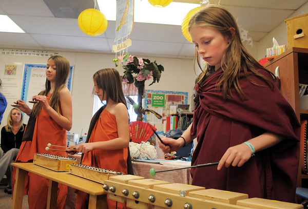 Genna Pachner, left, plays a Bodhi Day song with Payton Bellm and Caitie Smith during the 5th grade Winter Celebrations event on Thursday at Meridian Elementary School.<br /> December, 2010<br /> staff photo/David R. Jennings