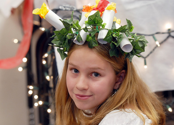 Amber Abila wearing a wreath with candles for the Swedish holiday of St. Lucia Day during the 5th grade Winter Celebrations event on Thursday at Meridian Elementary School.<br /> December, 2010<br /> staff photo/David R. Jennings