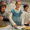 Hunter Brown, left, Destiny Raney and Iris Liu help celebrate Hanukkah during the 5th grade Winter Celebrations event on Thursday at Meridian Elementary School.<br /> December, 2010<br /> staff photo/David R. Jennings