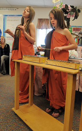 Genna Pachner, left, plays the cymbals while Payton Bellm plays the xylophone for Bodhi Day celebration for the 5th grade Winter Celebrations event on Thursday at Meridian Elementary School.<br /> December, 2010<br /> staff photo/David R. Jennings