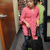 BE1125food04<br /> Grace Valdez, 9, a student council member at Meridian Elementary School, carries a shopping bag full of  food while helping fill 220 Thanksgiving food baskets for Federal Heights Elementary on Thursday.<br /> November 18, 2010<br /> staff photo/David R. Jennings