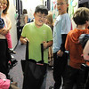 BE1125food06<br /> David Park, 9, student council member at Meridian Elementary School, carries a full shopping bag of food while helping fill 220 Thanksgiving food baskets for Federal Heights Elementary on Thursday.<br /> November 18, 2010<br /> staff photo/David R. Jennings