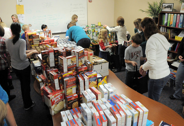 BE1125food12<br /> PTO parents and student council members at Meridian Elementary School prepare to fill 220 Thanksgiving food baskets for Federal Heights Elementary on Thursday.<br /> November 18, 2010<br /> staff photo/David R. Jennings