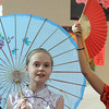 "Lauren Williams spins a parasol while singing a Chinese New Year related song during Meridian Elementary School fifth grader's winter holiday celebrations around the world on Thursday.<br /> More photos please see  <a href=""http://www.broomfieldenterprise.com"">http://www.broomfieldenterprise.com</a><br /> December 15, 2011<br /> Staff photo/ David R. Jennings"