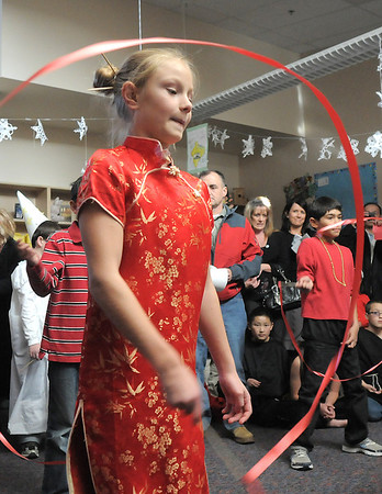 "Mckenna Thompson performs the ribbon dance for Chinese New Year  during Meridian Elementary School fifth grader's winter holiday celebrations around the world on Thursday.<br /> More photos please see  <a href=""http://www.broomfieldenterprise.com"">http://www.broomfieldenterprise.com</a><br /> December 15, 2011<br /> Staff photo/ David R. Jennings"