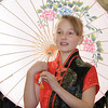 "Abby Mudgett, while twirling a parasol, sings for the Vietman celebration of Tet during Meridian Elementary School fifth grader's winter holiday celebrations around the world on Thursday.<br /> More photos please see  <a href=""http://www.broomfieldenterprise.com"">http://www.broomfieldenterprise.com</a><br /> December 15, 2011<br /> Staff photo/ David R. Jennings"