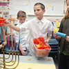 "Taylor Ballain, left, Tyler Boeckenstedt, Jackson Kramer and Emerson Herrmann hand out Hanukkah lights to parents during Meridian Elementary School fifth grader's winter holiday celebrations around the world on Thursday.<br /> More photos please see  <a href=""http://www.broomfieldenterprise.com"">http://www.broomfieldenterprise.com</a><br /> December 15, 2011<br /> Staff photo/ David R. Jennings"