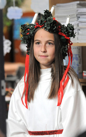 """Katelyn Adams dressed as St. Lucia for the Meridian Elementary School fifth grader's winter holiday celebrations around the world on Thursday.<br /> More photos please see  <a href=""""http://www.broomfieldenterprise.com"""">http://www.broomfieldenterprise.com</a><br /> December 15, 2011<br /> Staff photo/ David R. Jennings"""