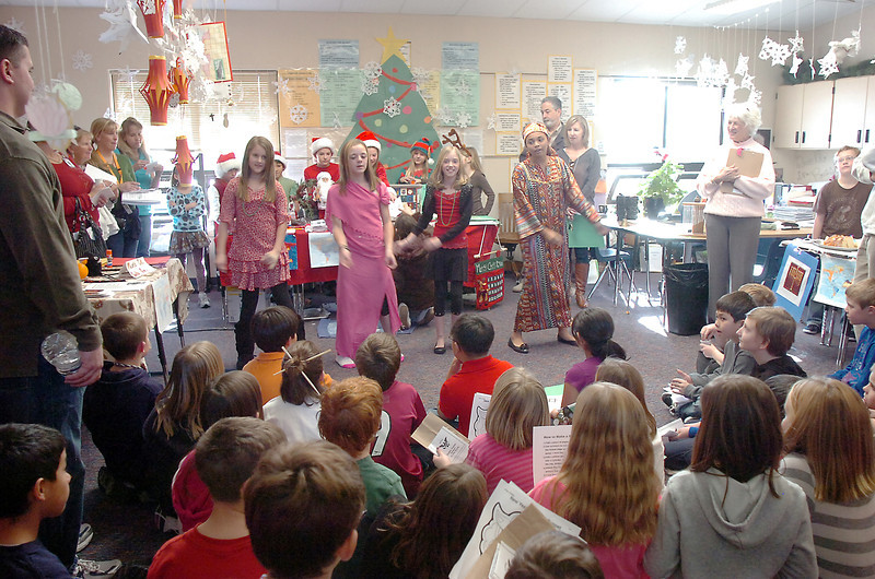 "A group sings a Kwansa song during Meridian Elementary School fifth grader's winter holiday celebrations around the world on Thursday.<br /> More photos please see  <a href=""http://www.broomfieldenterprise.com"">http://www.broomfieldenterprise.com</a><br /> December 15, 2011<br /> Staff photo/ David R. Jennings"