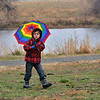 Rajan Keithley, 5, braves the rain and sleet with his rainbow umbrella during the opening ceremony for the Metzger Farm Open Space on Saturday.<br /> November 10, 2012<br /> staff photo/ David R. Jennings