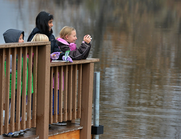 Aisha Prasad, 9, left, and Alexandra Nowakowski, 9, take pictures from a dock as they tour the Metzger Farm Open Space  which was opened to the publicon Saturday.<br /> November 10, 2012<br /> staff photo/ David R. Jennings