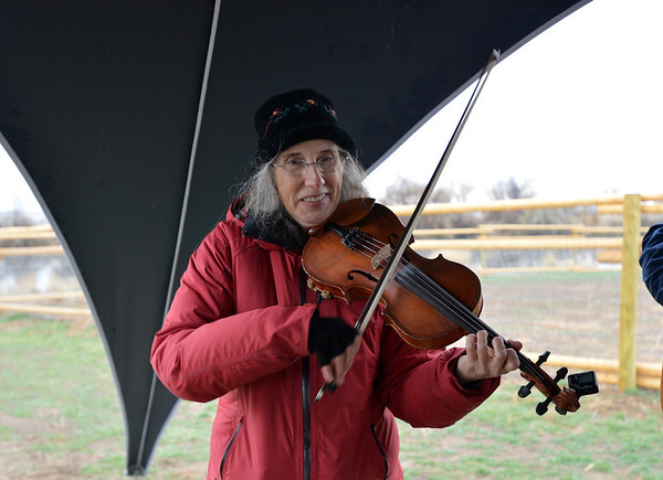 Anita Schuneman plays the violin for 40 Degrees North an old time american string band before the opening ceremony for the Metzger Farm Open Space on Saturday.<br /> November 10, 2012<br /> staff photo/ David R. Jennings