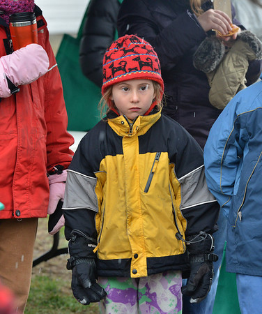 Tamsin Horne, 6, keeps warm during the opening ceremony for the Metzger Farm Open Space on Saturday.<br /> November 10, 2012<br /> staff photo/ David R. Jennings