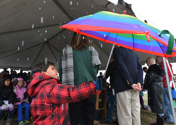 Rajan Keithley, 5, uses his umbrella to look at the snow during the opening ceremony for the Metzger Farm Open Space on Saturday.<br /> November 10, 2012<br /> staff photo/ David R. Jennings