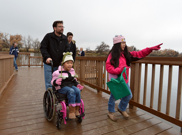 Noah Huffer walks with his daughters Lila, 7, left, and Anna, 9, while touring the area before the opening ceremony for the Metzger Farm Open Space on Saturday.<br /> November 10, 2012<br /> staff photo/ David R. Jennings