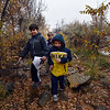 Ryan Chacon, 9, left, Jared Cleverley, 6, right, and his brother Tyler Cleverley, 10, center, look for signs of animal life in the Metzger Farm Open Space on Saturday. the open space was officially opened to the public on Saturday.<br /> November 10, 2012<br /> staff photo/ David R. Jennings