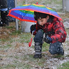 Rajan Keithley, 5, plays with the snow during the opening ceremony for the Metzger Farm Open Space on Saturday.<br /> November 10, 2012<br /> staff photo/ David R. Jennings