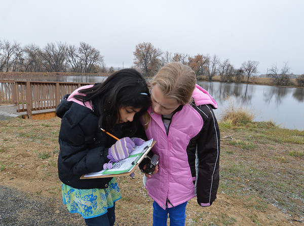 Aisha Prasad, 9, left, and Alexandra Nowakowski, 9, work on a paper for school after the Metzger Farm Open Space was opened to the public on Saturday.<br /> November 10, 2012<br /> staff photo/ David R. Jennings
