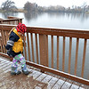 Tamsin Horne, 6, plays with the snow on a dock for a pond on the Metzger Farm Open Space, Saturday. the shared open space between Broomfield and Westminster opened to the public on Saturday.<br /> November 10, 2012<br /> staff photo/ David R. Jennings