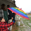 Rajan Keithley, 5, watches the snow using his umbrella  during the opening ceremony for the Metzger Farm Open Space on Saturday.<br /> November 10, 2012<br /> staff photo/ David R. Jennings