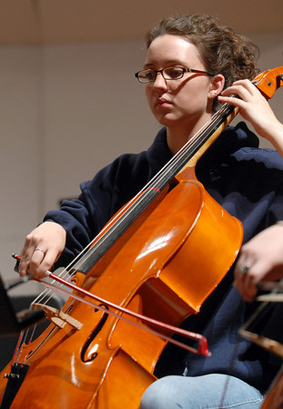 Broomfield High Orchestra cellist Hannah Morris plays during rehearsal before the benefit concert with Edgar Meyer and  Mike Marshall at the School on Saturday.<br /> <br /> April 17, 2010<br /> Staff photo/David R. Jennings