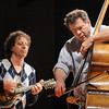 Mike Marshall, left, and Edgar Meyer play during the lecture-demonstration master class before the benefit concert for the orchestra at Broomfield High School on Saturday.<br /> <br /> April 17, 2010<br /> Staff photo/David R. Jennings