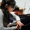 Pianist Amanda Ardito plays during rehearsal before the Broomfeild High Orchestra benefit concert with Edgar Meyer and  Mike Marshall at the School on Saturday.<br /> <br /> April 17, 2010<br /> Staff photo/David R. Jennings