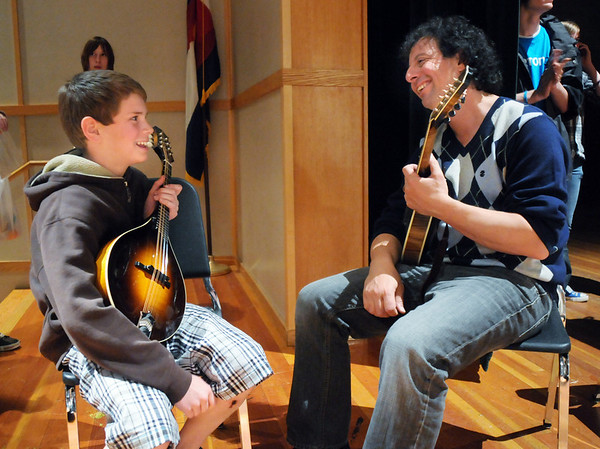 Mike Marshall, right, chats with Ivo Erben, 12, after they playing an impromtude mandolinan session during the lecture-demonstration master class with Edgar Mayer before the benefit concert for the Broomfield High orchestra at the school on Saturday. Erben has been playing the mandolin for one year.<br /> April 17, 2010<br /> Staff photo/David R. Jennings