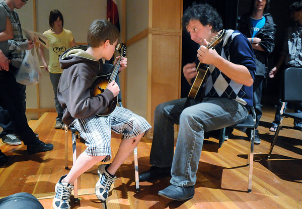 Mike Marshall, right, plays the mandolin with Ivo Erben, 12, in an impromtude session during the lecture-demonstration master class with Edgar Mayer before the benefit concert for the Broomfield High orchestra at the school on Saturday. Erben has been playing the mandolin for one year.<br /> <br /> April 17, 2010<br /> Staff photo/David R. Jennings